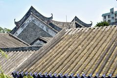 Unique Chinese Architecture. Rooftops Pagodas and Carvings. A unique perspective of ancient Chinese rooftops. They have carvings and interesting patterns on them Stock Photo