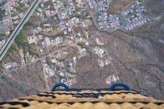 Unique perspective. Hot air balloon view from above. Unique perspective looking down on a hot air balloon from above royalty free stock image