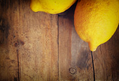 Unique perspective of lemons over wooden board background. top view Royalty Free Stock Photography