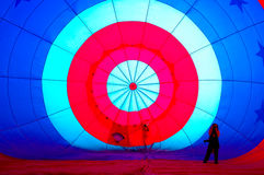 Unique perspective. A photographer stands inside a Hot Air Balloon as it is being blow up prior to adding hot gas to get it in the air.  The balloon was being Stock Image