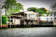 Ghost House in Bangkok Thailand. This unique photo shows how the old Bangkok looks like and how people live in simple circumstances on the Mae Nam Chao Phraya royalty free stock images