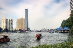 Long Tail Boat in Bangkok Thailand. This unique photo shows like the old traditional long tail boats driving on the Mae Nam Chao Phraya River in Bangkok royalty free stock photos