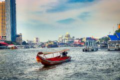 Long Tail Boat in Bangkok Thailand. This unique photo shows like the old traditional long tail boats driving on the Mae Nam Chao Phraya River in Bangkok royalty free stock image