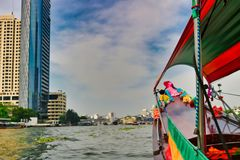 Long Tail Boat in Bangkok Thailand. This unique photo shows like the old traditional long tail boats driving on the Mae Nam Chao Phraya River in Bangkok stock photos