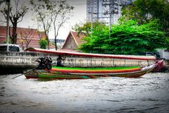Long Tail Boat in Bangkok Thailand. This unique photo shows like the old traditional long tail boats driving on the Mae Nam Chao Phraya River in Bangkok stock image