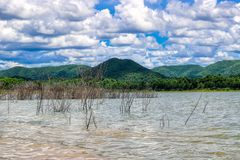 Lake in Kaeng Krachan National Park in Thailand with hills. This unique picture shows the beautiful nature with hills and trees and the great reservoir in the royalty free stock images