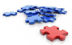 Unique piece. Red puzzle piece opposite to a group of blue pieces Royalty Free Stock Photo