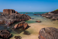 Rock formations at St. Mary island. Unique pillar-like natural rock formations seen at St. Mary Island, Karnataka, India Royalty Free Stock Image