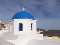 The unique pure white and vivid blue Greek islands style church at Oia village on Santorini island Stock Photography