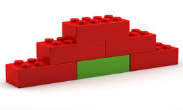 Unique red block in the pyramid basis. On white background Royalty Free Stock Photos