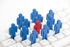 Unique person in the crowd on computer keyboard royalty free stock image