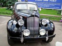 Unique retro car. Black packard Stock Images