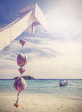 Unique retro filtered coconut decoration on tropical beach Stock Photos