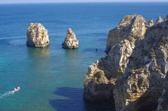 Unique rock formations of Algarve coast. Projecting out of the sea at Ponta da Piedade, just outside Lagos town in Portugal Stock Image