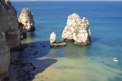 Unique rock formations of Algarve coast. Projecting out of the sea at Ponta da Piedade, just outside Lagos town in Portugal Stock Photo