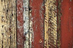 Old unique faded red barn wall background. Unique rust barn wood weathered background with copy space Royalty Free Stock Photos
