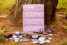 Unique sign with kindness rocks. Unique sign for the instructions of the kindness rocks with painted rocks Stock Photos