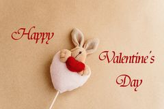 Unique simple hand made bunny with heart on craft background, ha Royalty Free Stock Images
