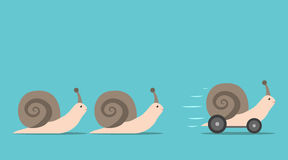 Unique snail with wheels. Unique successful fast moving snail with wheels in front of some slow ones. Competition, competitive advantage and innovation concept Royalty Free Stock Images
