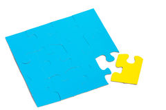 Unique solution. Blue puzzle and yellow puzzle (concept of a unique problem and solution Royalty Free Stock Photos