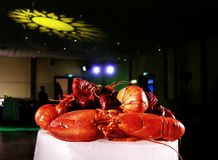 Unique and special dinner event. Big lobsters on top of the ice blocks before the guests arrive Stock Photos