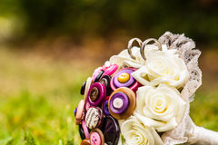 Unique stule wedding bouquet with wedding rings. Wedding details like wedding gold rings and tiara crown makes a wedding more special and bring great memories Royalty Free Stock Image