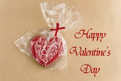Unique stylish red heart cookie, happy valentine`s day text Stock Photo