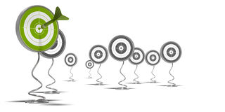 Unique success and marketing. Targets mouted on pedestal, there is a green target on the foreground and grey ones at the background a dart hit the green one Royalty Free Stock Image