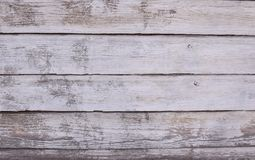 The unique texture of uneven painted white oil paint wooden old boards stock photo