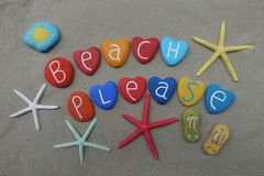 Beach Please text with multicolored heart stones over natural sand Royalty Free Stock Image