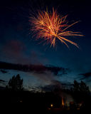 Unique view from behind a firework show in the blue sky of early Royalty Free Stock Photography