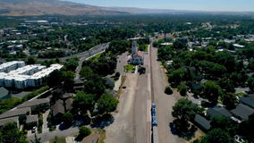 Unique view of the Boise Train depot with a train passing. Aerial following a train past a depot station stock footage
