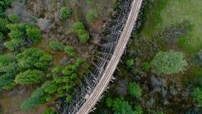 Unique view of a historic train trestle and forest. Half moon train trestle and Idaho forest stock video