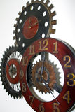 Unique Wall Clock. A unique clock hangs on the wall of a new home Stock Image