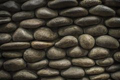A unique wall texture using natural Rounded stone. A unique wall natural Rounded stone background picture Stock Photos
