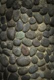 A unique wall texture using naturally rounded stone. A unique wall naturally rounded stone background picture Stock Image