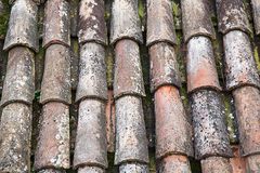 Unique, weathered terracotta roof background Stock Photo