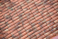 Unique, weathered terracotta roof background Stock Image