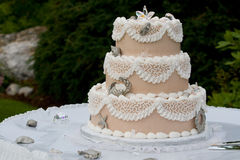Unique Wedding cake. Wedding cake adorned with pewter royalty free stock photo