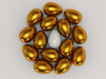 Unique white egg among gold eggs Royalty Free Stock Photography