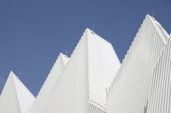 Unique white triangular shaped aluminum metal roof designed Stock Images