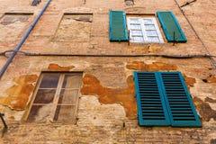 Unique windows in Siena, Italy Royalty Free Stock Photos