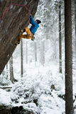 Unique winter sports. Rock climber on a challenging ascent. Extreeme climbing. Stock Photography
