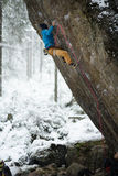 Unique winter sports. Rock climber on a challenging ascent. Extreeme climbing. Stock Image