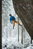 Unique winter sports. Rock climber on a challenging ascent. Extreeme climbing. Royalty Free Stock Images