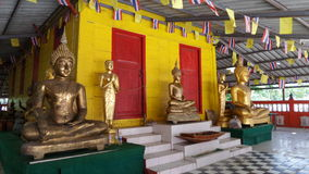 Unique yellow and red painted on wooden Buddhist chapel Royalty Free Stock Photos