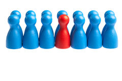 Uniqueness or autism concept, alone among group. Single different red pawn in center of large group of uniform people. Concept for autism, loneliness, uniqueness Stock Photo