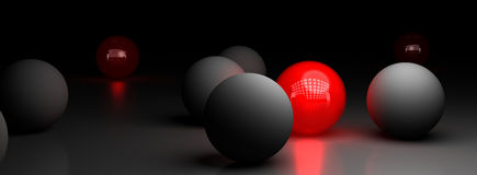Uniqueness, Be Different Background Over Black. One red ball illuminating many grey spheres over a black background, symbol of difference royalty free illustration