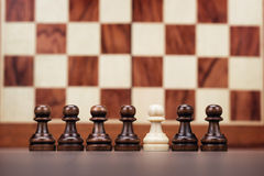Uniqueness concept over chessboard background. Uniqueness concept on the table chessboard background Royalty Free Stock Photos