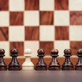 Uniqueness concept over chessboard background Royalty Free Stock Photos